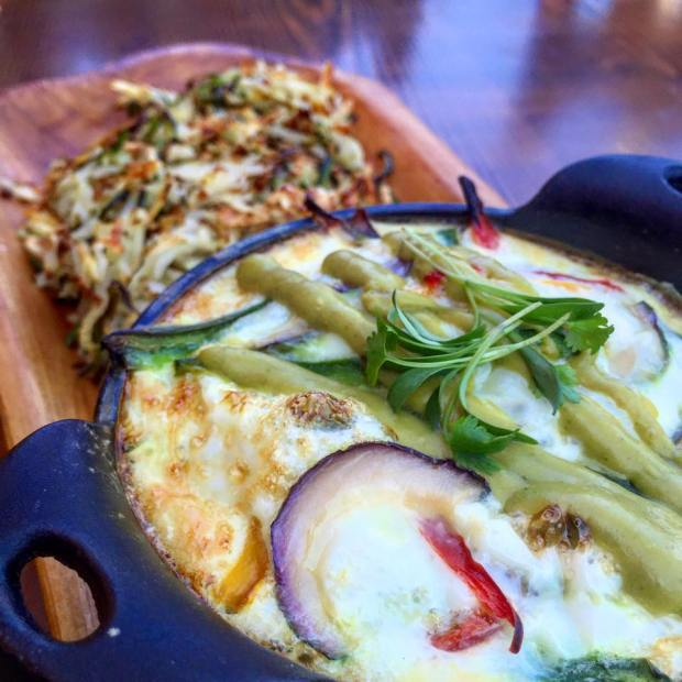 Via their FaceBook Page: Baked Egg Whites with jalapeños, tomatoes, scallions, bell peppers, green poblano drizzle